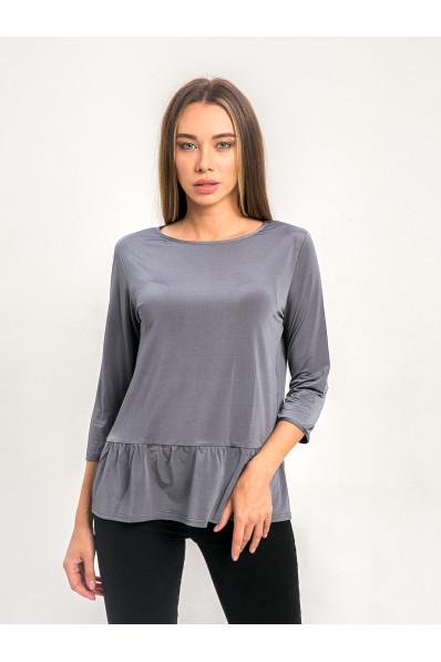 1022-2 - Эффектная блузка прямого силуэта из шелковистого полотна с эффектом блеска. Рукав длиной  7/8. По низу притачана широкая оборка.