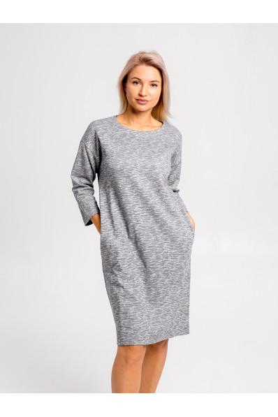 2011 - Платье свободного силуэта выполнено из плотного меланжевого полотна. Плечо спущено, свободный рукав 3/4, в боковых швах карманы.