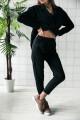 8991 - Укороченные брюки из плотного трикотажного полотна с карманами в боковых швах. Притачной пояс на резинке. В шов притачивания вставлены декоративные шлевки из разноцветной тесьмы.